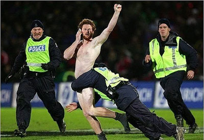 Streaker on a mobile phone.