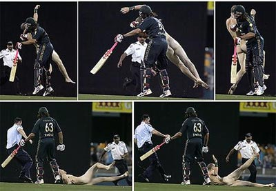 Andrew Symonds knocks over the streaker